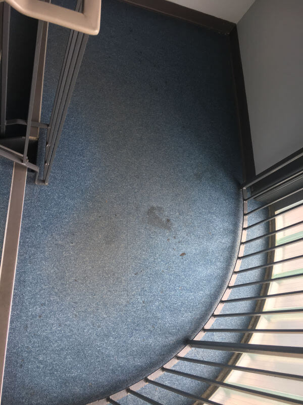 Communal stair carpet before being cleaned